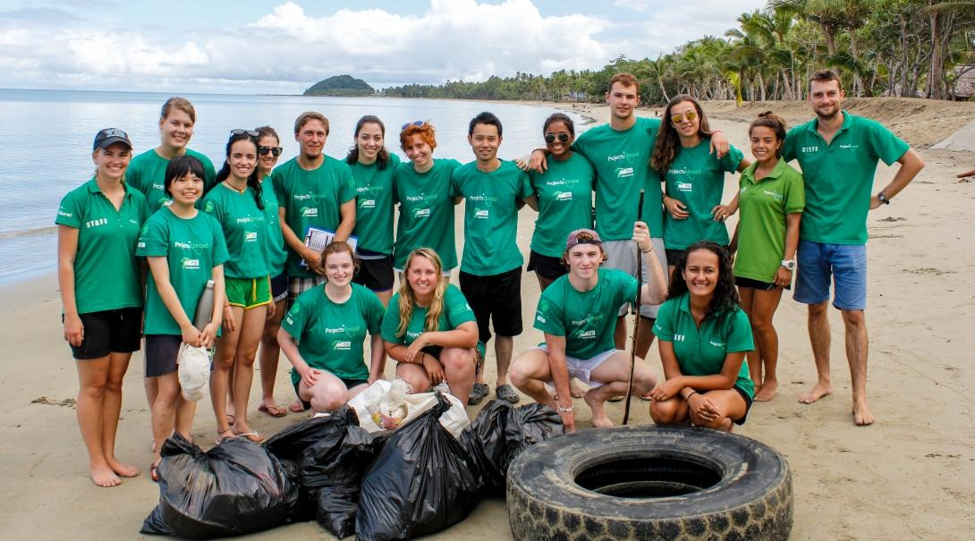 Projects Abroad Conservation volunteers pick up litter on one of our best volunteer abroad programs for young adults.